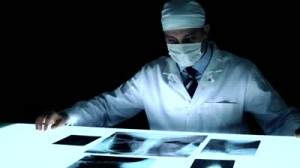 stock-footage-healthcare-doctor-carefully-examining-x-ray-medical-concept